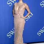 Sara Sampaio shinned at the 2018 CFDA Fashion Awards wearing a plunging shimmery nude ruffled gown by J. Mendel cinching in her waist with a gold belt. (Photo: WENN)