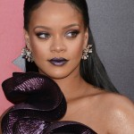 "Rihanna paired her already eye-catching ruffled dress with an even bolder dark purple metallic lipstick at the world premiere of her movie ""Ocean's 8."" (Photo: WENN)"