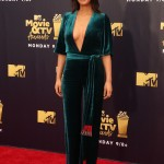 Olivia Munn looked super glam in a low-cut emerald green velvet Galvan jumpsuit and matching belt with red and silver fringes Galvan at the 2018 MTV Movie & TV Awards. (Photo: WENN)