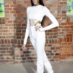 Winnie Harlow rocked an all-white ensemble consisting of a long-sleeve crop top and high-waisted trousers at the HUGO show held during the Berlin Fashion Week. (Photo: WENN)