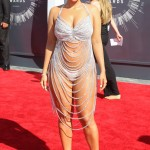 Amber Rose heated up the red carpet for the 2014 VMA's in a scandalous body-baring chain dress that could barely contain her prominent curves. (Photo: WENN)