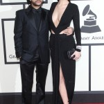 "The Weeknd looks like a shorty next to Bella Hadid. But, I mean, who wouldn't? The woman is pretty damn tall—5'10"" according to her IMG Models profile. (Photo: WENN)"