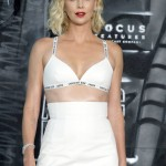 "43-year-old Charlize Theron rocked a white bra and mini skirt combo by Christian Dior, paired with a bright red lip at the ""Atomic Blonde"" premiere in Berlin. (Photo: WENN)"