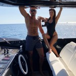 Kourtney and Younes put their love (and enviable hot, toned bodies) on full display by cuddling up on a boat during their Italian getaway. (Photo: Instagram)