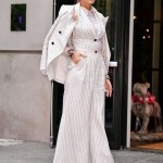 Mrs. Reynolds channeled her inner Elvis in an all-white pin-striped Zimmermann suit with a long-line blazer draped around her shoulder as she strolled around N.Y.C. (Photo: WENN)