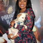 "Jordin Sparks was all smiles as she cuddled with this cute dog at the premiere of GLOBAL Road Entertainment's ""Show Dogs."" (Photo: WENN)"