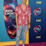 Grant Gustin, it kind of looks like you walked into a Target, grabbed the summer sale items and threw them on without second thought. (Photo: WENN)