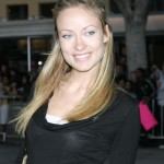 Between her solid blonde color, pale shimmery eyeshadow, and overplucked brows, Olivia Wilde embodied the early '00s beauty movement. (Photo: WENN)