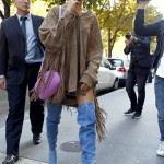 Hailey Baldwin paired her western-inspired oversized fringed button-down with a statement pair of of over-the-knee denim boots. (Photo: WENN)