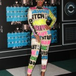Amber Rose arrived at the VMA's red carpet wearing a wild high-neck jumpsuit covered in colorful derogatory words to challenge slut-shaming. (Photo: WENN)