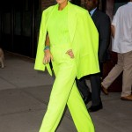 Blake Lively stepped out in a jaw-dropping neon green Versace suit and matching knit shirt, combined with a pair of multi-colored pumps. (Photo: WENN)