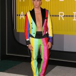 Fashion designer Jeremy Scott straight rocked it in this rainbow-striped colorful tuxedo with no shirt at the 2015 Video Music Awards red carpet. (Photo: WENN)