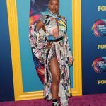 We don't know what's the worst part from Michelle Mitchenor's outfit— whether the oddly-placed cut-outs, the overwhelming print, or those combat boots. (Photo: WENN)