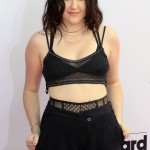 Noah Cyrus set the Billboard Music Awards 2018 on fire as she stepped out wearing a silk triangle bra-like knitted black top. (Photo: WENN)