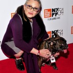 Star Wars legend Carrie Fisher hugged her precious French bulldog Garry on the red carpet at the 54th annual New York Film Festival. (Photo: WENN)