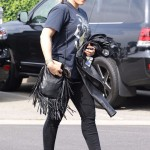 Hilary Duff completed her casual outfit with a pair of light denim ankle boots as se strut around in Los Angeles. (Photo: WENN)