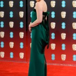 Amy lloked spellbinding in a strapless emerald column Tom Ford gown with cut-out back and velvet bow detail at the 2017 BAFTA red carpet. (Photo: WENN)
