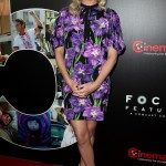 Charlize Theron attended CinemaCon 2017 sporting a cocktail purple floral dress by Gucci with puffy sleeves and a delicate bow around the neck. (Photo: WENN)