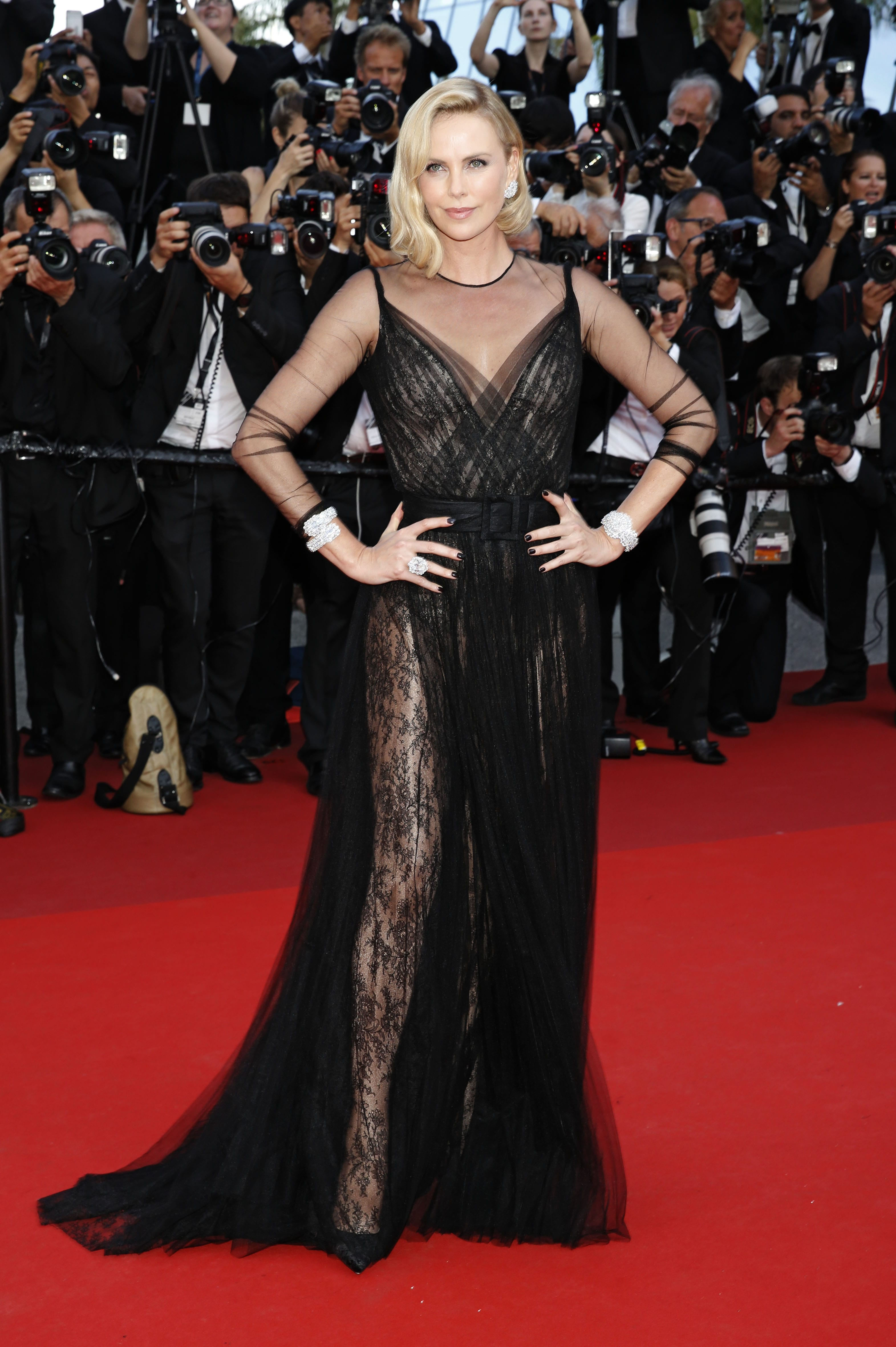 8c37a5d4ec Charlize Theron arrived at the Cannes Film Festival 70th Anniversary Gala  in full glam