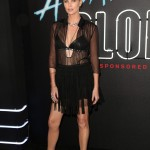 "The ""Atomic Blonde"" star attended the L.A. premiere of her movie rocking a bondage-inspired ensemble with black leather bra, fringed mini skirt and ankle-high booties. (Photo: WEN)"