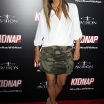 "The actress effortlessly rocked a camouflage print skirt and white-linen oversized wrap shirt at the premiere of ""Kidnap."" (Photo: WENN)"