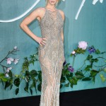 "The ""Mother!"" actress went sheer, silver, and sultry for the London premiere of her movie wearing a figure-hugging glittery fishnet Atelier Versace dress. (Photo: WENN)"
