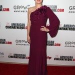 Adams hit a fashion high note in a vibrant plum one-sleeved floral gown custom designed by Andrew Gn at the 2017 American Cinematheque Awards Gala. (Photo: WENN)