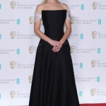 The actress showcased her toned curves in an elegant off-the-shoulders black gown by Dior with daring semi-sheer back at the 2018 BAFTAs. (Photo: WENN)