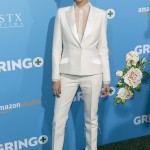 "Theron suited up for the L.A. premiere of the movie ""Gringo"" wearing a a hot-white tuxedo by Dior and a sheer, see-through button up blouse. (Photo: WENN)"
