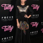 "Charlize Theron spread her glamorous wings in a floor-length black dress covered in metallic butterflied, designer by Christian Dior, at the premiere of her movie ""Tully."" (Photo: WENN)"