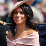 The Duchess of Sussex made her Trooping of the Colour debut in a custom made, off-the shoulder Carolina Herrera blushed pink ensemble that perfectly match her incredible hat. (Photo: WENN)