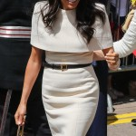 Markle arrived in Cheshire for her first solo engagement with the Queen wearing a modest, structured cream Givenchy dress featuring a cape detail over her shoulders. (Photo: WENN)