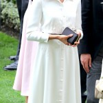 Meghan Markle made her Royal Ascot debut in an elegant white button-up dress by Givenchy with a contrasting skinny black belt that matched the detailing of her statement hat. (Photo: WENN)