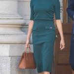 The former actress showed sartorial diplomacy as she arrived in Ireland wearing a forest green patch pocket pencil skirt and matching short-sleeve blouse, designed by Givenchy. (Photo: WENN)