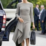 Markle spent her second day in Dublin in a taupe-gray dress designed by her friend Roland Mouret featuring her favorite bateau neckline and a unique waterfall skirt. (Photo: WENN)