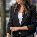 The Duchess of Sussex visited the home of Ireland President in a sleek pair of black trousers paired with a Givenchy blazer with oversized shoulders accentuating her tiny frame. (Photo: WENN)