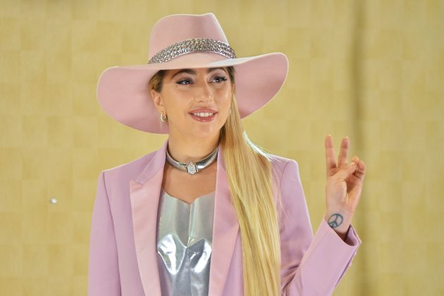 "Lady Gaga posing for the cameras at the photocall for her album ""Joanne."" (Photo: WENN)"