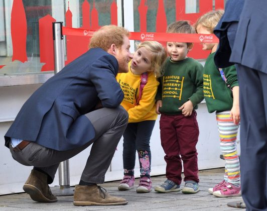 Because Prince Harry knows how to act around kids. He's had plenty of practice with his nephew George, his niece Charlotte, and newborn Prince Louis—not to mention kids clearly love him back! Talk about daddy material! (Photo: WENN)