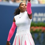 Serena switched up the classic tennis pleats the 2016 U.S. Open wearing a white and pink ensemble with coordinating sneakers. (Photo: WENN)