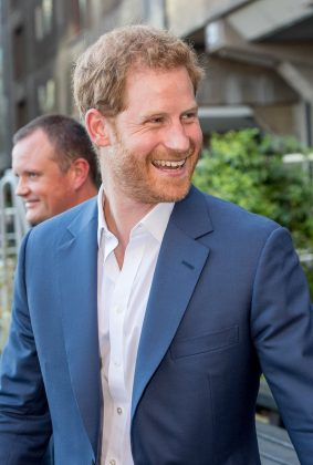 """Because despite being a jokester, he's also a hopeless romantic. """"When did I know she was """"the one?"""" The very first time we met,"""" Harry said about the lucky, lucky Meghan Markle. (Photo: WENN)"""