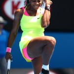 Serena Williams shined at the court of the 2015 Australian Open wearing a neon pink and yellow ensemble with a daring cutout in the back. (Photo: WENN)
