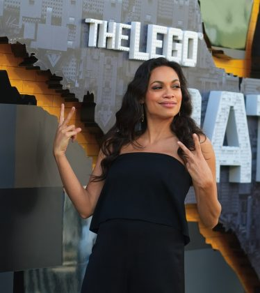 "Rosario Dawson serving us some double deuces at the premire of ""The LEGO Batman Movie."" (Photo: WENN)"