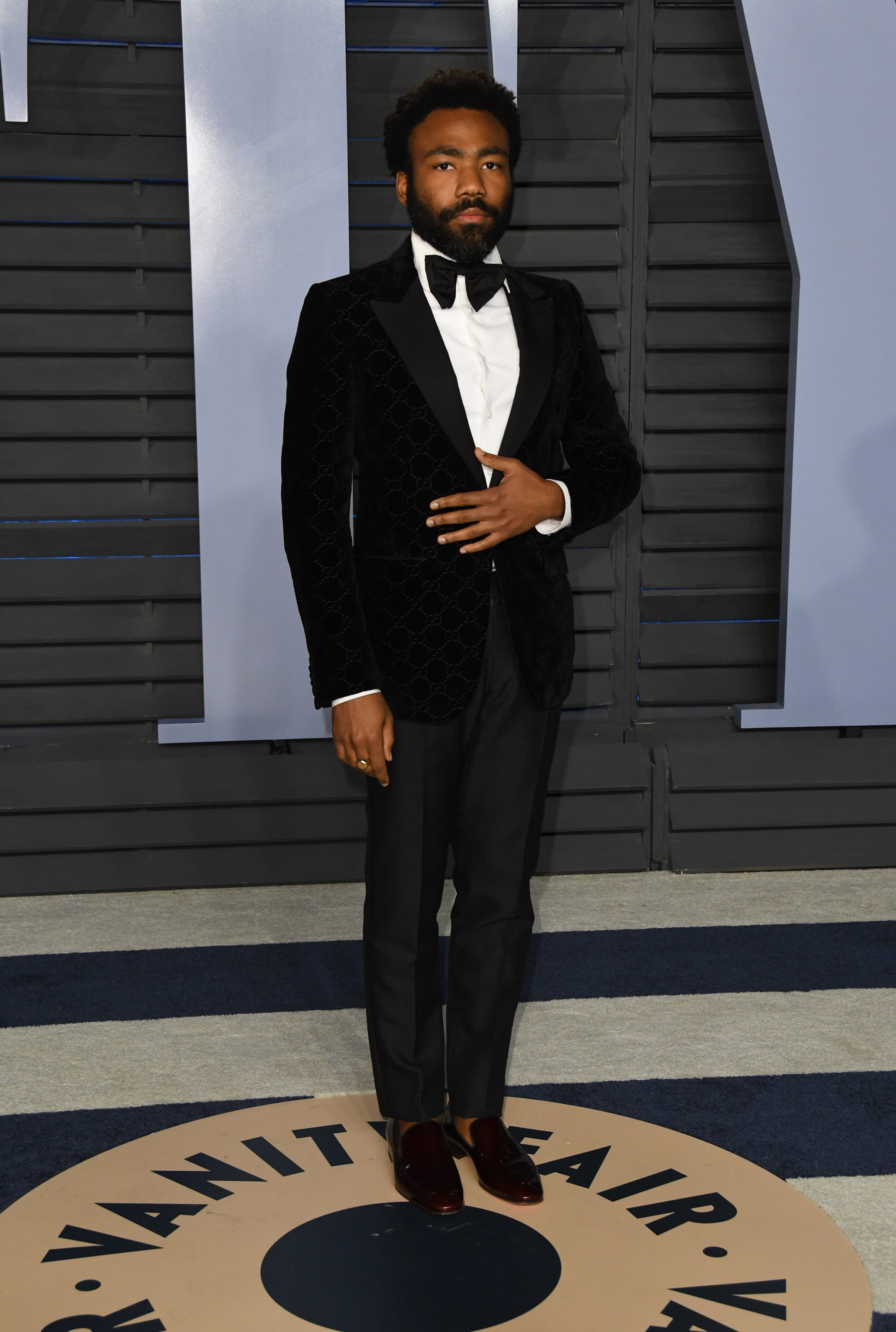 52d7b4089 Donald opted for a handsome-luxe approach with a Gucci velvet jacket in  partnership with