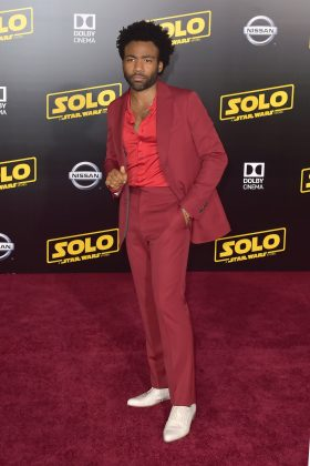 "The ""Solo: A Star Wars Story"" star went for a two-toned red-on-red look that contrasted with his stark white pair of shoes. (Photo: WENN)"