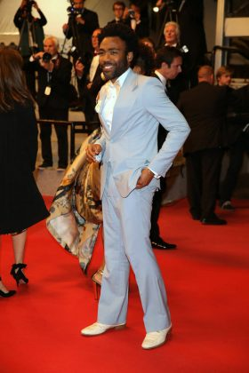 "The 35-year-old actor wore a custom powder blue Gucci jacket and matching wide-legged pants at the ""Solo: A Star Wars Story"" premiere in Cannes. (Photo: WENN)"