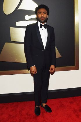 Childish Gambino was one of the best dressed men at the 2015 Grammys in a classic black Lanvin tux, keeping it cool with the ankles out. (Photo: WENN)