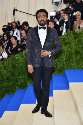 "Donald attended the 2017 ""Rei Kawakubo & Comme des Garçons"" Met Gala wearing a custom elaborate-print navy Gucci jacket from Burberry. (Photo: WENN)"