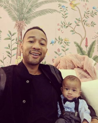 "John Legend posing alongside his new-born Miles for a cute father and son picture. ""Reunited,"" he captioned the photo. (Photo: Instagram)"