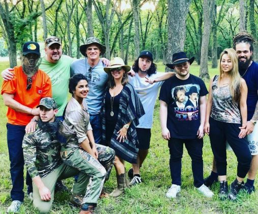 Soon-to-be husband and wife Nick Jonas and Priyanka Chopra getting cozy in camo while enjoying a while vacay in Oklahoma. (Photo: Instagram)