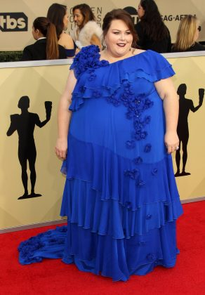 "The ""This Is Us"" star made quite an appearance at the 2018 SAG Awards red carpet wearing a romantic royal blue gown with ruffled edges and tiny flower detailing. (Photo: WENN)"